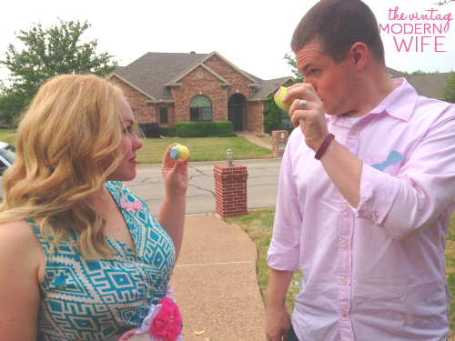 The Vintage Modern Wife and her husband with their gender reveal confetti eggs