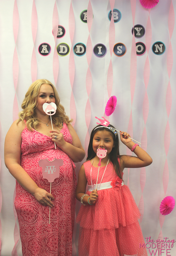A photo booth for a baby shower is a great baby shower idea! Print out the pictures for your guests and send them with their thank you card!