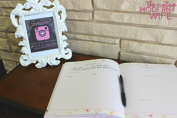 this instagram sign is perfect at the guest book table for a pink baby shower for