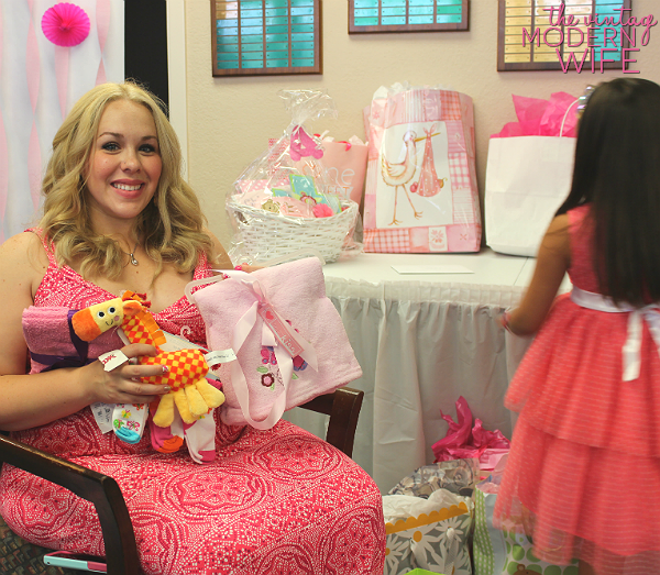Lots of presents at a beautiful pink baby shower