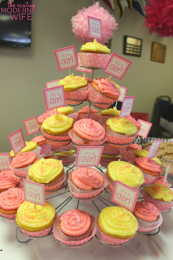 Love this tower of pink and yellow cupcakes for a pink baby shower for a girl!