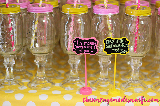 I love this mason jar wine glass party favor for a lemonade first birthday party. What a good idea!