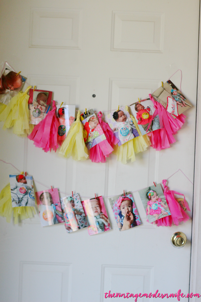 Love this birthday banner with monthly pictures of their baby for her lemonade first birthday party! What a cute idea for the door!