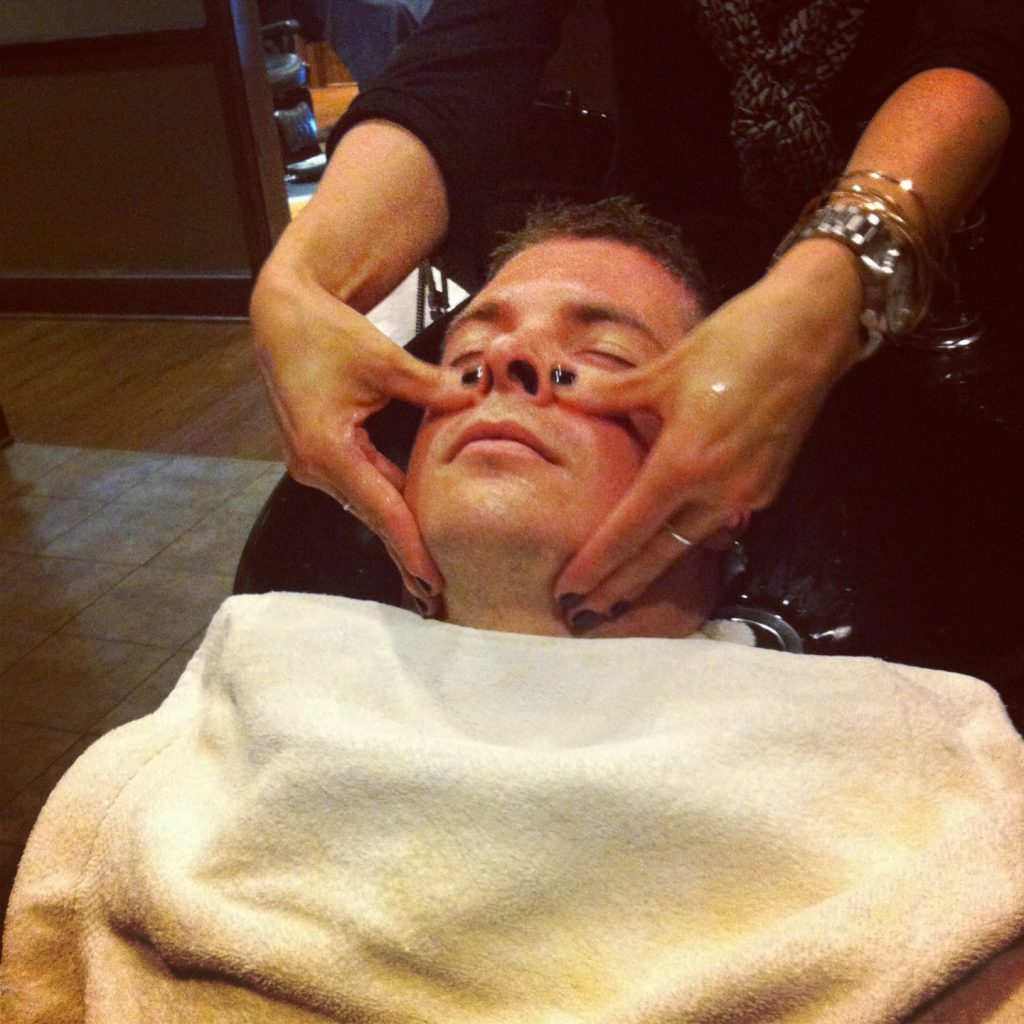 Mathew getting a face massage at The Boardroom