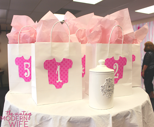 These prize bags at the pink baby shower for The Vintage Modern Wife are so adorable. Love that the winners have to draw their number to make it fair!