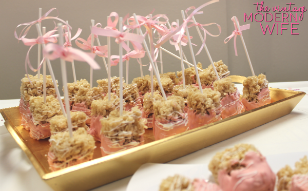 These pink chocolate covered rice krispy treats are perfect for a pink baby shower for a girl!