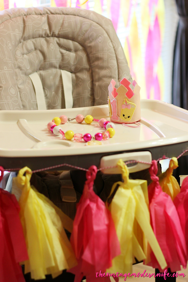 This high chair is decorated so perfectly for the cutest lemonade first birthday party! Plus, that crown and bracelet are precious! Pinning this because there are so many other great lemonade birthday party pictures on this blog!