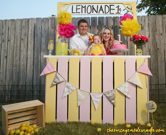Looking for a lemonade themed 1st birthday photo shoot? This one from The Vintage Modern Wife is TOO cute. With the perfect lemonade stand and props, this lemonade 1st birthday party set up is sweet as can be! The lemonade stand is so perfect too!